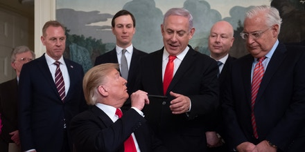 US President Donald Trump hands his pen to Israeli Prime Minister Benjamin Netanyahu after signing a Proclamation on the Golan Heights in the Diplomatic Reception Room at the White House in Washington, DC, March 25, 2019. - US President Donald Trump on Monday signed a proclamation recognizing Israeli sovereignty over the disputed Golan Heights, a border area seized from Syria in 1967.