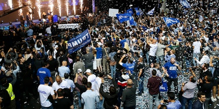 TOPSHOT - Supporters of the Israeli Likud Party celebrate as Prime Minister Benjamin Netanyahu waves to them at its headquarters in the Israeli coastal city of Tel Aviv on election night on April 9, 2019. (Photo by Jack GUEZ / AFP)        (Photo credit should read JACK GUEZ/AFP/Getty Images)