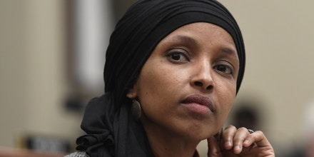 Rep. Ilhan Omar, D-Minn., listens as Office of Management and Budget Acting Director Russell Vought testifies before the House Budget Committee on Capitol Hill in Washington, Tuesday, March 12, 2019, during a hearing on the fiscal year 2020 budget. (AP Photo/Susan Walsh)