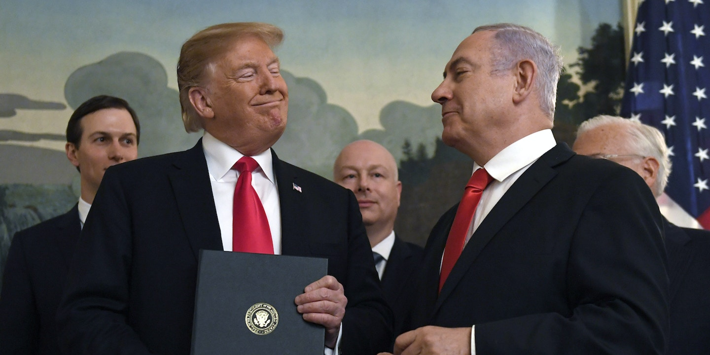 President Donald Trump, second from left, smiles at Israeli Prime Minister Benjamin Netanyahu, right, after signing a proclamation in the Diplomatic Reception Room at the White House in Washington, Monday, March 25, 2019. Trump signed an official proclamation formally recognizing Israel's sovereignty over the Golan Heights. (AP Photo/Susan Walsh)