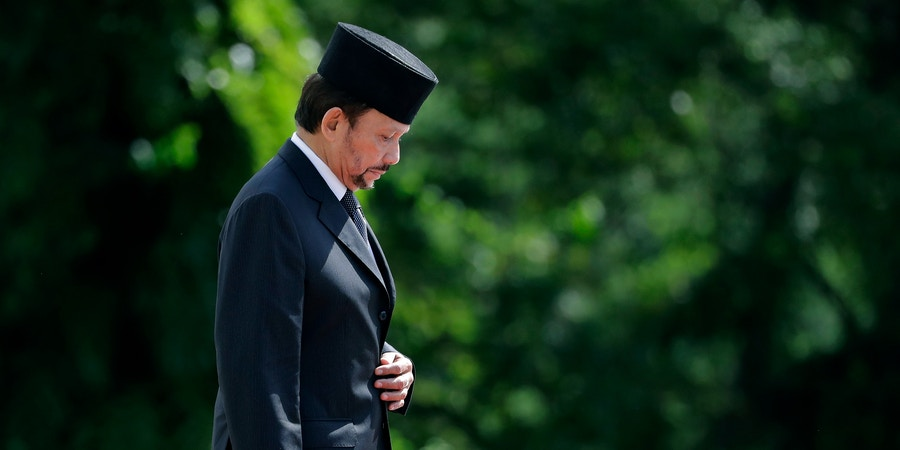 Brunei's Sultan Hassanal Bolkiah proceeds to inspect honor guards during a welcome ceremony at the Istana on Wednesday, July 5, 2017, in Singapore. (AP Photo/Wong Maye-E)