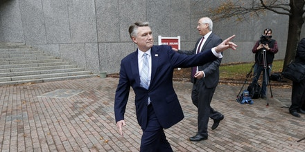 Mark Harris, center, Republican candidate for North Carolina's 9th Congressional District seat, and his attorney David Freedman, right, leave after speaking with the media outside the state elections board building, Thursday, Jan. 3, 2019, in Raleigh, N.C. Harris and his lawyers met for about two hours with board investigators examining absentee ballot irregularities in the 9th District. No candidate has been certified the 9th District winner while the investigation continues. (Ethan Hyman/The News & Observer via AP)