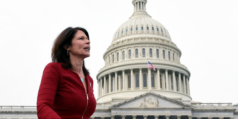 Rep. Cheri Bustos, D-Ill., walks to a group photo with the women of the 116th Congress on Capitol Hill in Washington, Friday, Jan. 4, 2019. (AP Photo/Susan Walsh)