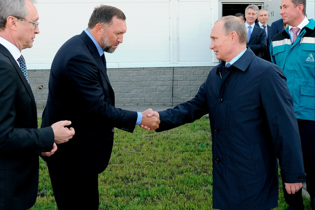 FILE - In this Sept. 19, 2014 file-pool photo, Russian President Vladimir Putin, right, shakes hands with Russian metals magnate Oleg Deripaska while visiting the RusVinyl plant in Kstovo, in Russia's Nizhny Novgorod region. D(AP Photo/RIA-Novosti, Mikhail Klimentyev, Presidential Press Service, File)