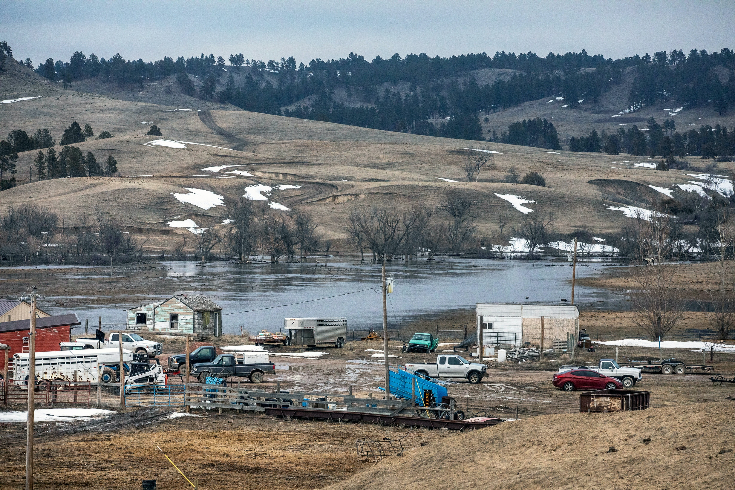 In this Monday, March 25, 2019 photo, water from White Clay Creek pools near the ranch of Ernie Little on the Pine Ridge Indian Reservation, near Pine Ridge, S.D. (Ryan Hermens/Rapid City Journal via AP)