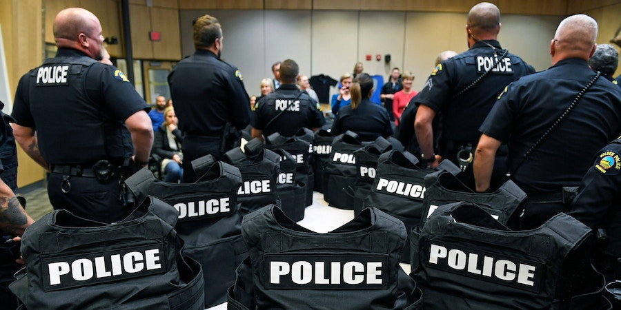 GOLDEN, CO - NOVEMBER 15:  New high end police body armor kits sit on tables before being given to members of the Golden Police department  by Shield 616 inside the Golden city council chambers on November 15, 2018 in Golden, Colorado. The kit comes with two armor plates, one for the front and one for the back, a ballistic helmet, which only stops hand gun bullets, an individual trauma aid kit  and a vest in which to put the plates.  Shield 616, a Colorado Springs non-profit that provides enhanced body armor kits to police officers, presented 26 kits to the Golden Police department. Former Colorado Springs police officer Jake Skifstad responded to the shooting at the New Life church in 2007 that killed two and injured five. After the suspect was killed, Skifstad was assigned to guard the body. Reflecting on the situation as he stood guard he realized the armor he was wearing would only stop handgun fire and this shooter had a rifle. Out of that he started Shield 616 which supplies enhanced armor that will withstand rifle fire. Each kit costs about $2500. (Photo by Helen H. Richardson/The Denver Post via Getty Images)