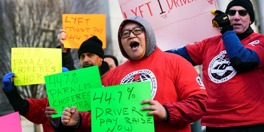 NEW YORK, NY - MARCH 18: Members and supporters of the Independent Drivers Guild protest against Lyft, which is challenging the way the Taxi and Limousine Commission calculates the minimum wage for drivers, at a hearing before the commission outside of New York state Supreme Court, March 18, 2019 in New York City. Lyft, the popular ride-hailing service and competitor to Uber, is planning its initial public offering (IPO) on the NASDAQ stock exchange in the coming weeks. Lyft has projected investors would buy the stock for between $62 and $68 per share, with the company expecting to raise over $2 billion through the sale of stock. (Photo by Drew Angerer/Getty Images)