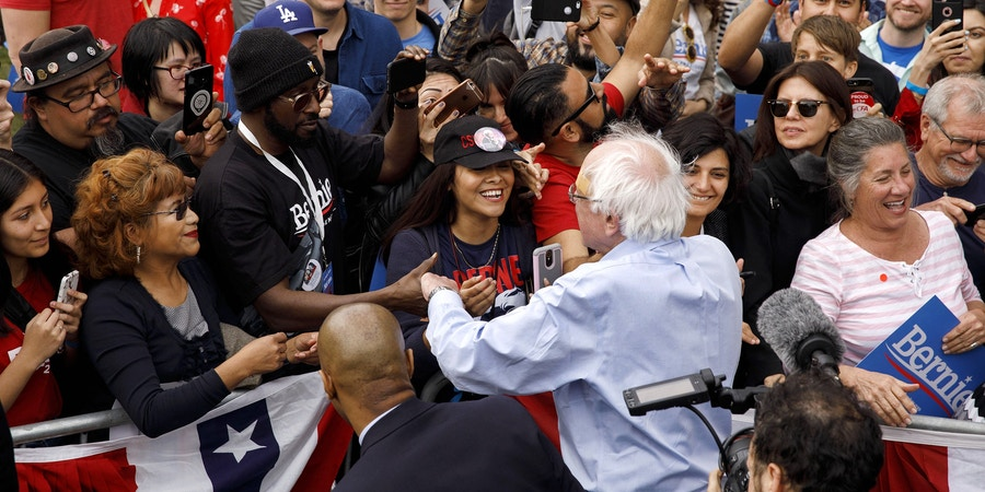 Senator Bernie Sanders, an Independent from Vermont and 2020 presidential candidate, center, greets attendees during a campaign rally in Los Angeles, California, U.S., on Saturday, March 23, 2019. No longer a fringe candidate or an outsider, Sanders will be under pressure to score decisive victories in early contests for the Democratic nomination or risk seeing his 2020 candidacy deflate. Photographer: Patrick T. Fallon/Bloomberg via Getty Images