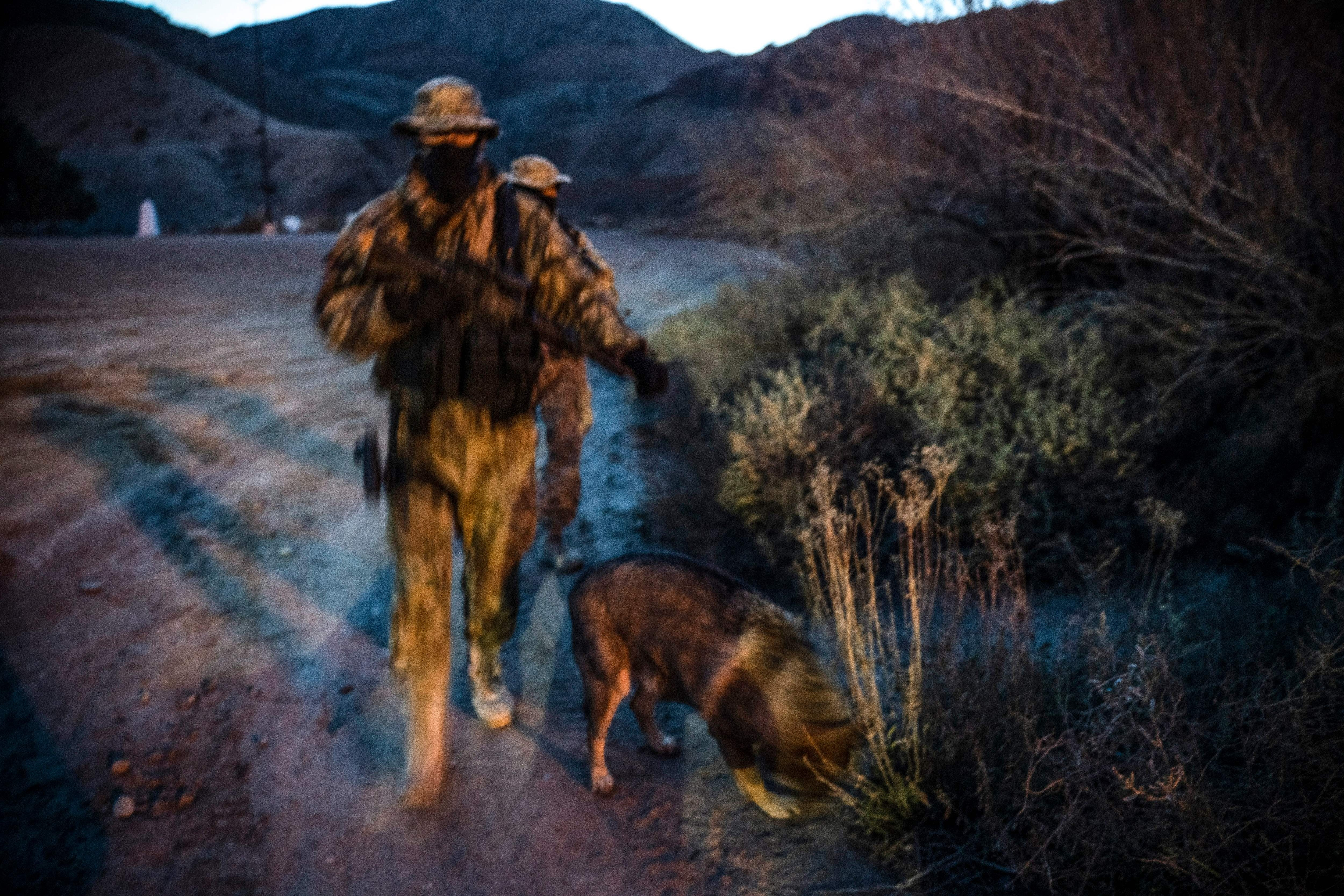 "Members of the Constitutional Patriots New Mexico Border Ops Team militia, Viper and Stinger who go by aliases to protect their identity, patrol the US-Mexico border in Sunland Park, New Mexico on March 20, 2019. - The militia members say they will patrol the US-Mexico border near Mt. Christo Rey, ""Until the wall is built."" In recent months, thousands of Central Americans have arrived in Mexico in several caravans in the hope of finding a better life in the United States. US President Donald Trump has branded such migrants a threat to national security, demanding billions of dollars from Congress to build a wall on the southern US border. (Photo by Paul Ratje / AFP)(Photo credit should read PAUL RATJE/AFP/Getty Images)"