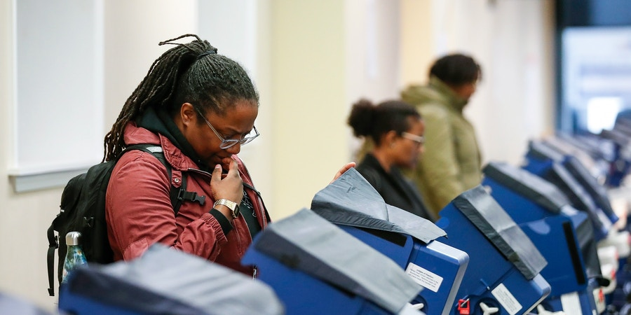 Voters cast their ballots at the polling place in downtown Chicago, Illinois on April 2, 2019. - Chicago residents went to the polls in a runoff election Tuesday to elect the US city's first black female mayor in a historic vote centered on issues of economic equality, race and gun violence. Lightfoot and Toni Preckwinkle, both African-American women, are competing for the top elected post in the city. (Photo by Kamil Krzaczynski / AFP)        (Photo credit should read KAMIL KRZACZYNSKI/AFP/Getty Images)