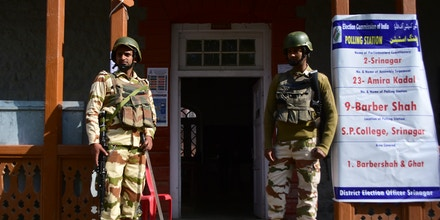 Indian Government forces remain alert outside a deserted polling booth in Srinagar district during the second phase of parliamentary elections in Indian Administered Kashmir on 18 April 2019. Most of the voting boots were empty after the Election Boycott call by Pro-freedom Leadership. Three districts of Kashmir valley Srinagar, Budgam and Ganderbal are undergoing the polling currently.  (Photo by Muzamil Mattoo/NurPhoto via Getty Images)