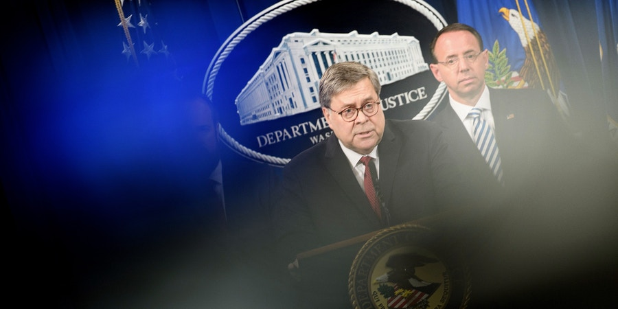US Deputy Attorney General Rod Rosenstein (R) listens while Attorney General William Barr speaks during a press conference about the release of the Mueller Report at the Department of Justice April 18, 2019, in Washington, DC. - US Attorney General Bill Barr said Thursday that the White House fully cooperated with Special Counsel Robert Mueller's probe of Russian election meddling and that President Donald Trump took no action to thwart the probe.