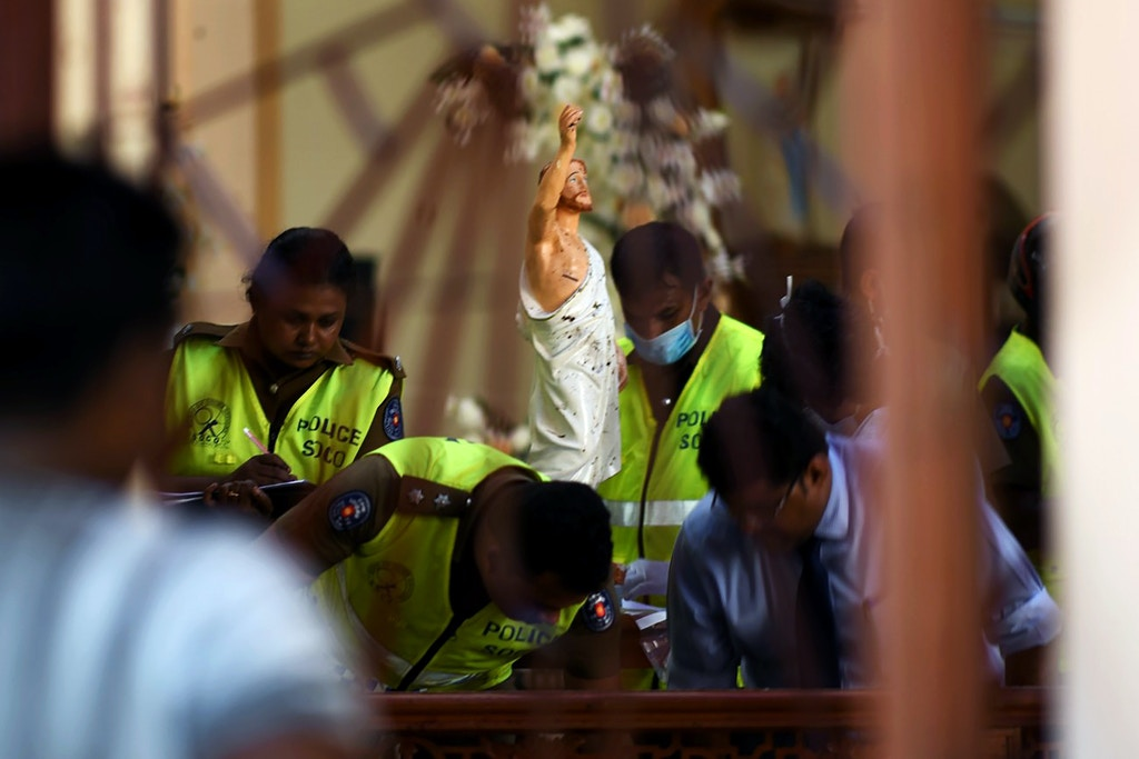 Security personnel inspect inside St. Sebastian's Church in Negombo on April 22, 2019, a day after the church was hit in series of bomb blasts targeting churches and luxury hotels in Sri Lanka. - The death toll from bomb blasts that ripped through churches and luxury hotels in Sri Lanka rose dramatically April 22 to 290 -- including dozens of foreigners -- as police announced new arrests over the country's worst attacks for more than a decade. (Photo by Jewel SAMAD / AFP)        (Photo credit should read JEWEL SAMAD/AFP/Getty Images)
