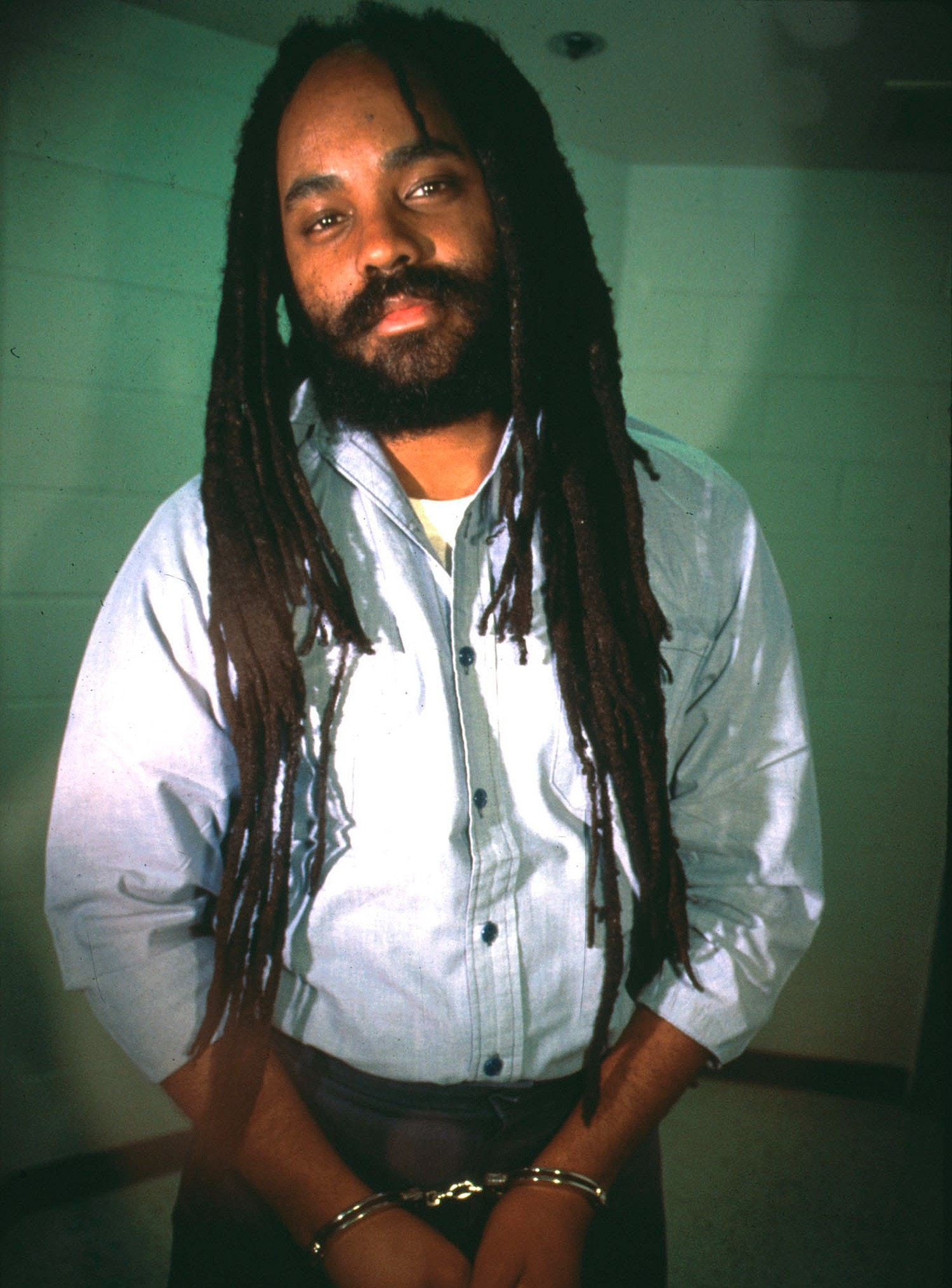 N 248921 03: ***EXCLUSIVE*** Pennsylvania death row inmate Mumia Abu-Jamal, seen here in a December 13, 1995 photo from prison, was convicted in 1982 of murdering a Philadelphia policeman. Police in Washington D.C. arrested dozens of Abu-Jamal supporters February 28, 2000, who were demanding a new trial for Abu Jamal, and the abolition of the death penalty in the United States. (Photo by Lisa Terry / Liaison Agency)
