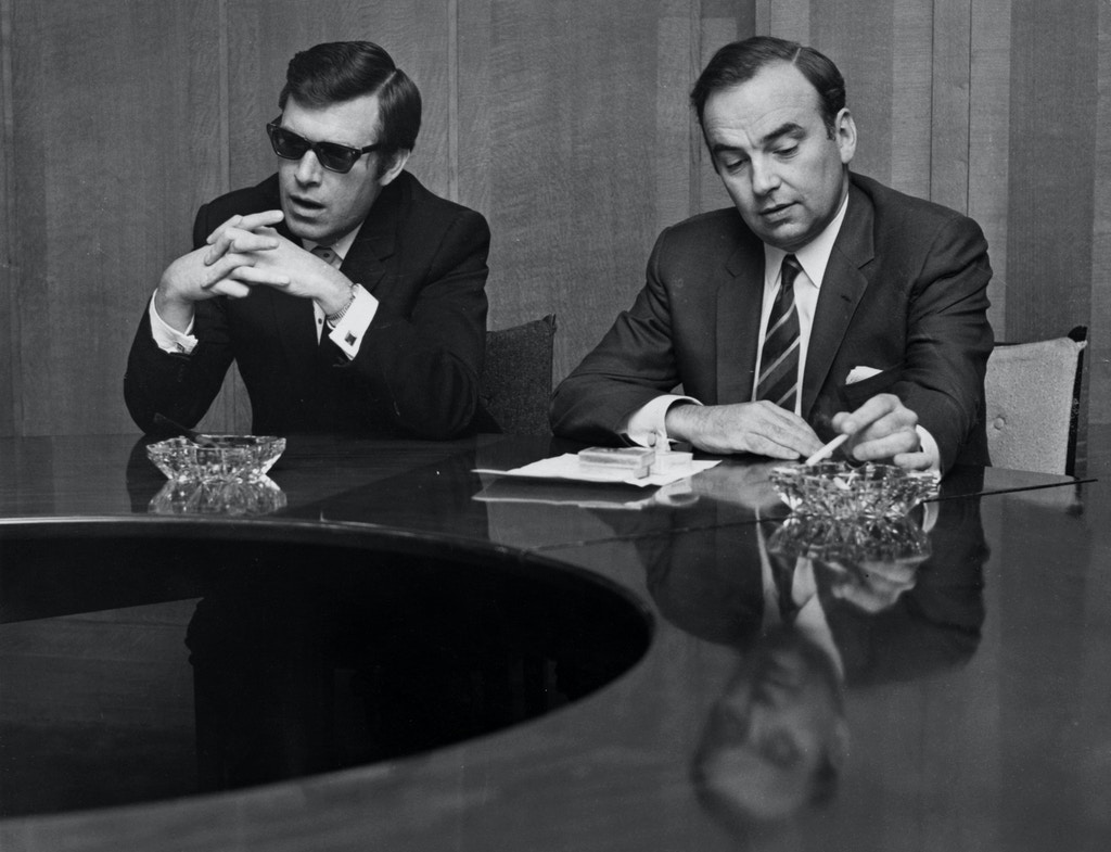 Larry Lamb (left), the new editor of 'The Sun' at a press conference at the 'News of the World' offices with media magnate Rupert Murdoch, owner of 'News of the World', 25th October 1969.   (Photo by Gary Weaser/Keystone/Hulton Archive/Getty Images)