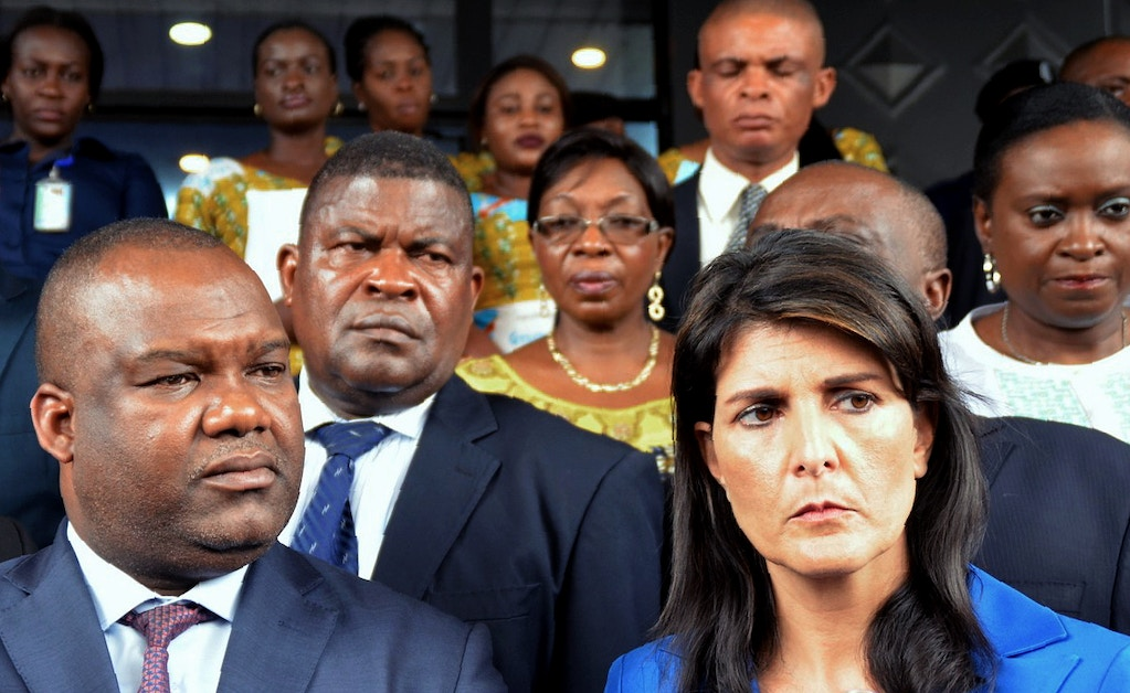 The US ambassador to the United Nations, Nikki Haley (R), meets DR Congo's national independent electoral commission's president Corneille Nangaa Yobeluo at its headquarters in Kinshasa on October 27, 2017.The US ambassador to the United Nations, Nikki Haley, told the Democratic Republic of Congo to hold elections next year, rather than delay them until 2019, if it wanted to count on American backing. / AFP PHOTO / TUTONDELE MIANKEN (Photo credit should read TUTONDELE MIANKEN/AFP/Getty Images)