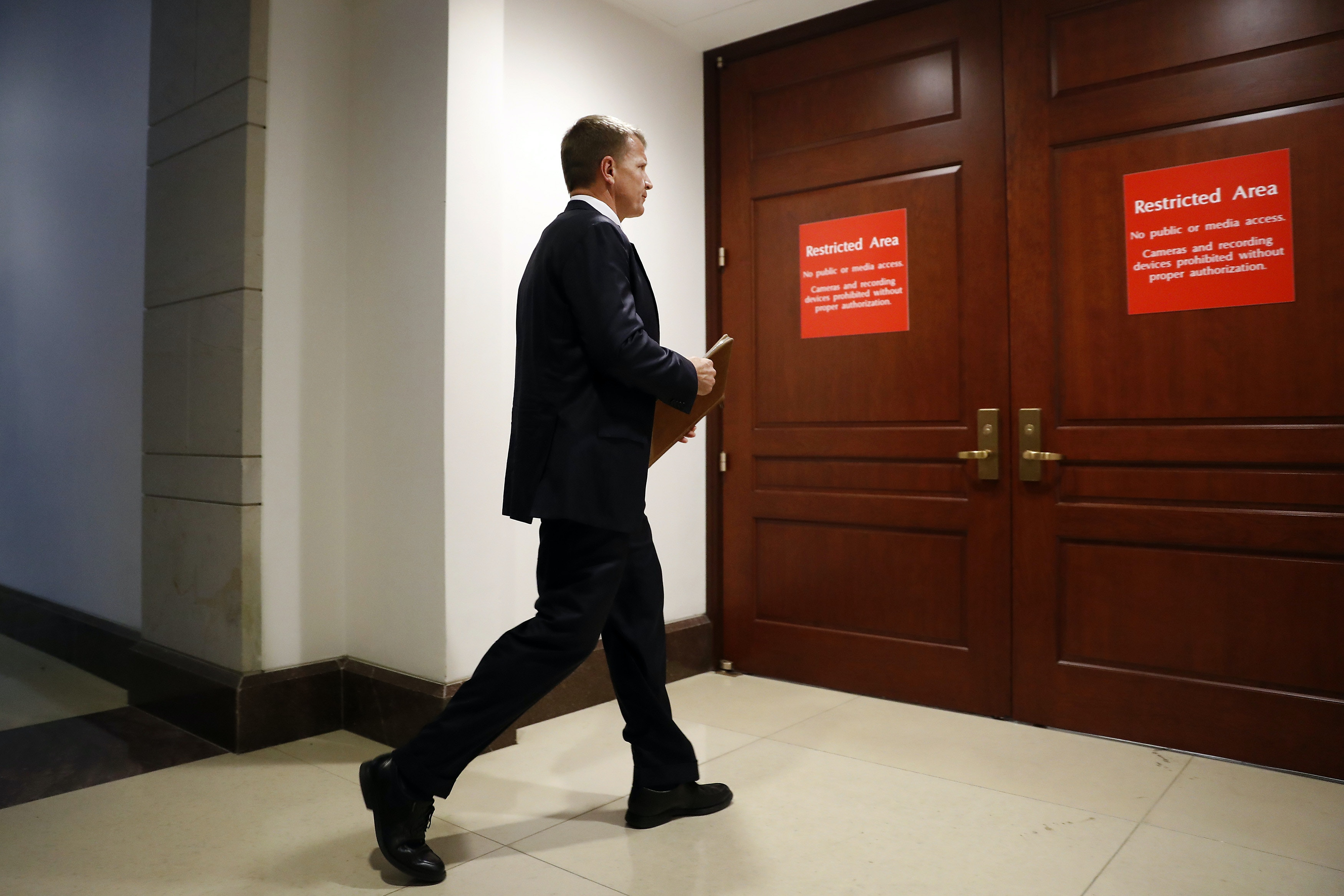 Erik Prince, chairman and executive director of Frontier Services Group Ltd., walks to a closed-door House Intelligence Committee meeting on Capitol Hill in Washington, D.C., U.S., on Thursday, Nov. 30, 2017. Prince, best known for running the Blackwater private security firm whose employees were convicted of killing Iraqi citizens, was a presence during Donald Trump's presidential transition and worked in part with Michael Flynn. Photographer: Aaron P. Bernstein/Bloomberg via Getty Images