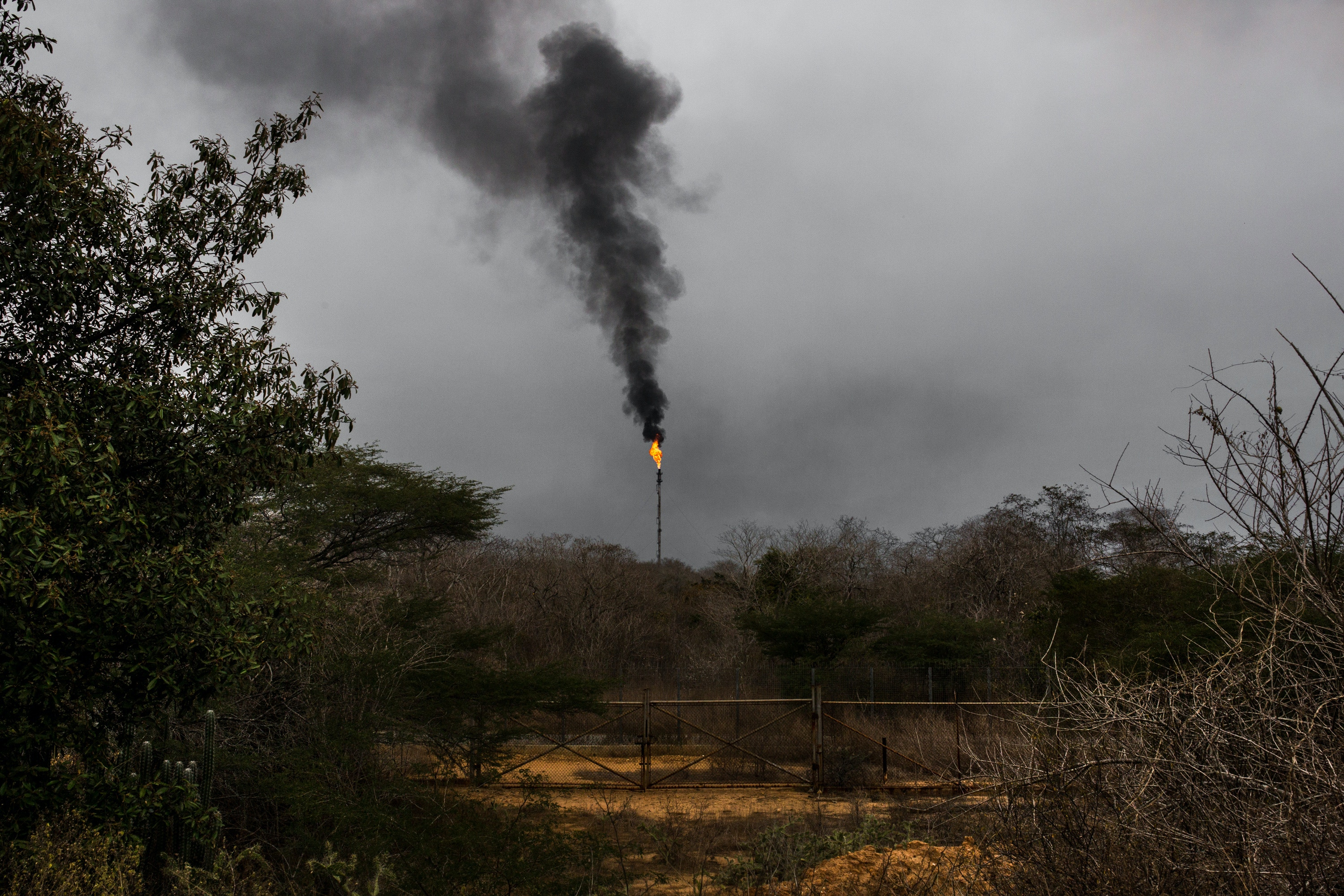 A gas flare is seen at the Petroleos de Venezuela SA (PDVSA) Jose Antonio Anzoategui industrial complex (CIJAA) in Barcelona, Anzoategui state, Venezuela, on Thursday, Feb. 8, 2018. Hunger is hastening the ruin of Venezuelan's oil industry as workers grow too weak and hungry for heavy labor. Absenteeism and mass resignations mean few are left to produce the oil that keeps the tattered economy functioning. Photographer: Wil Riera/Bloomberg via Getty Images