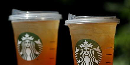 SAUSALITO, CA - JULY 09:  A new flat plastic lid that does not need a straw is shown on a cup of Starbucks iced tea on July 9, 2018 in Sausalito, California. Starbucks announced today that it plans on phasing out all plastic straws from its 28,000 stores worldwide by 2020. Some of its drinnk cups will be fitted with special flat plastic lids that can be used without straws.  (Photo by Justin Sullivan/Getty Images)