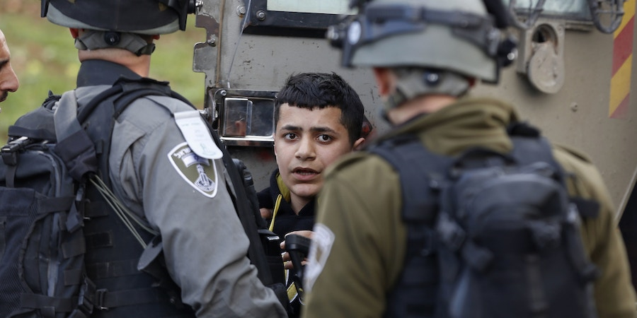 Israeli border policemen arrest a young Palestinian during clashes following a protest to killed a Palestinian militant Basil al-Araj by Israeli forces early Monday, in front of the Israeli Ofer prison, near the West Bank city of Ramallah,, Tuesday, March 7, 2017.(AP Photo/Majdi Mohammed)??