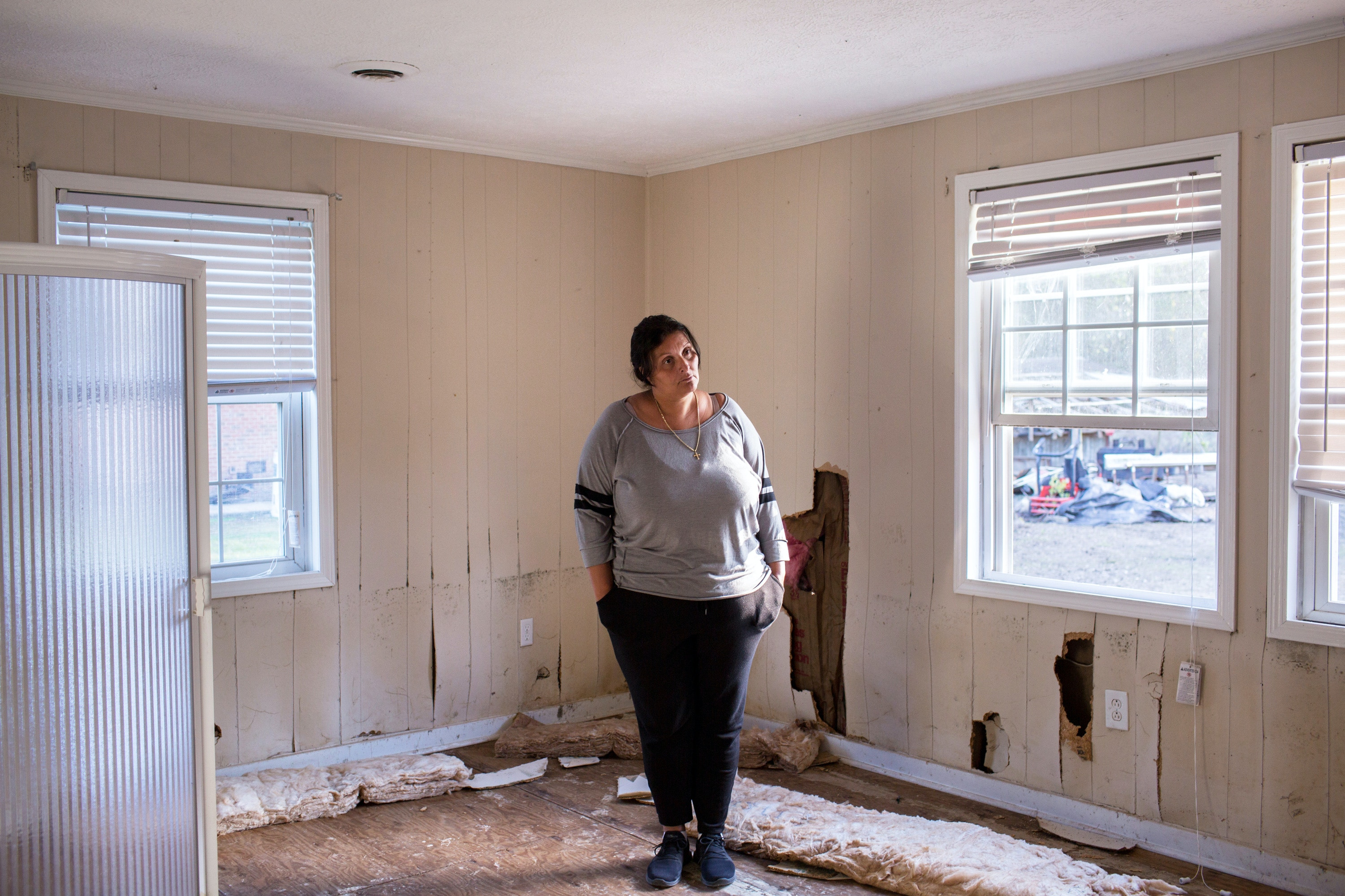 Latisha Jones poses for a portrait in her home, which has been condemned, in Maxton, N.C., about 25 miles northwest of Lumberton. Photo: Natalie Keyssar