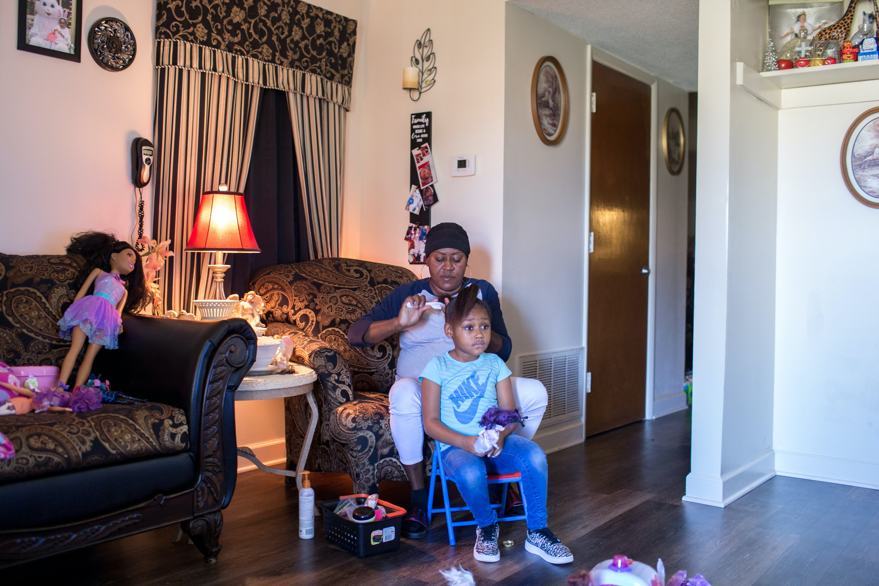 October 25, 2018. Lumberton NC. Alicia Huggins and her daughter Na-Vaya at home in Lumberton NC. Alicia and her family were flooded and ended up in emergency shelters during both storms. Alicia, who is pregnant and battling thyroid cancer, said after a week in the shelter this time she decided she would rather live in her damaged home for the health and safety of her family because conditions were so bad.