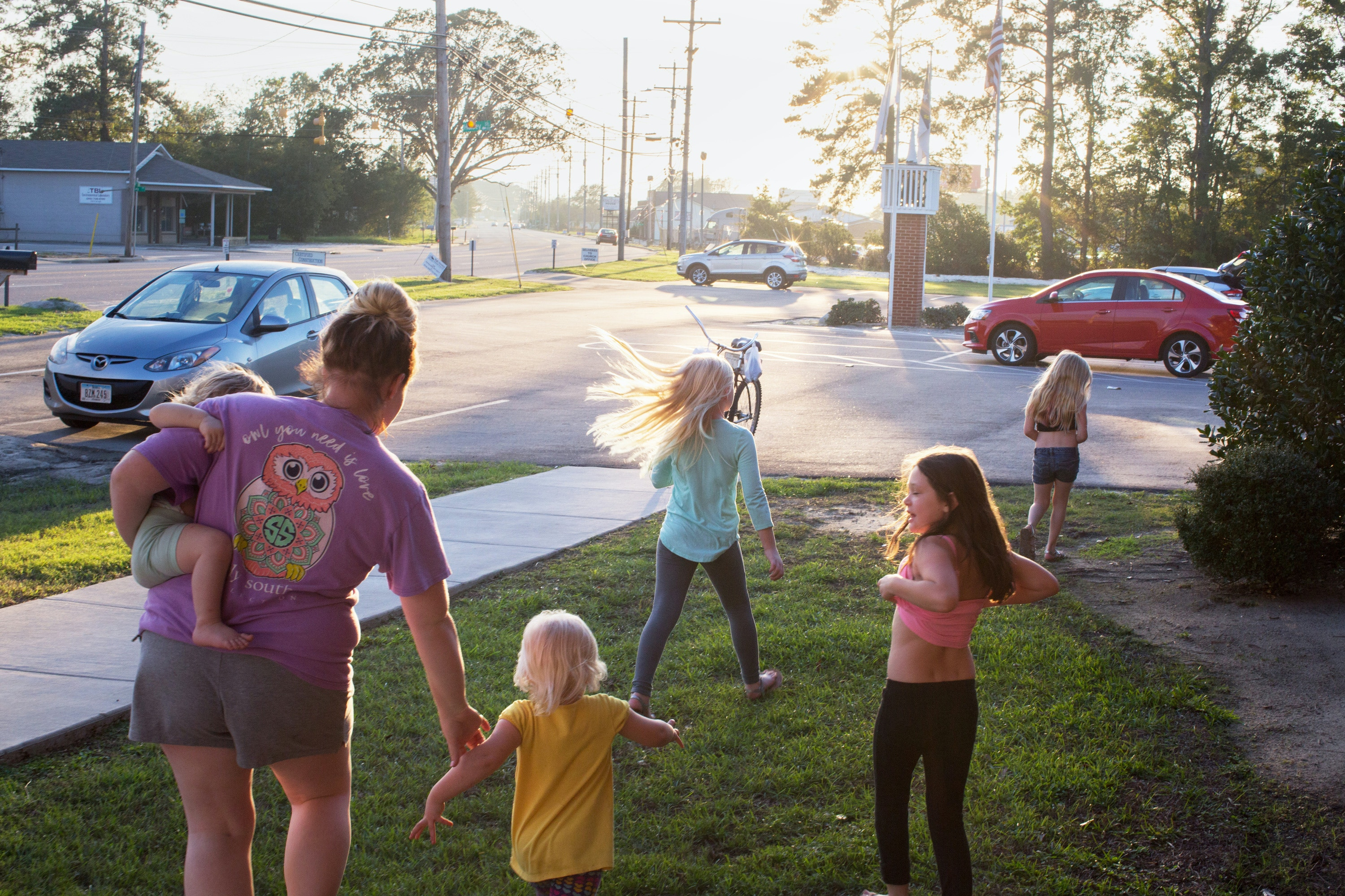 October 21, 2018. Lumberton NC. Lauren Herring and her daughters walk towards an aid distribution center at West Lumberton Baptist, a church that was flooded during both storms. Lumberton, North Carolina is the seat of one of the poorest counties in the nation. In 2016, it was catastrophically flooded due to Hurricane Matthew creating a first crop of people who fled their homes permanently, and left hundreds who were hanging on by a thread financially and physically as they prayed for FEMA aid and other donations to help them rebuild and suffered from systemic neglect. Just as the community finally began to recover, hurricane Florence hit, causing flooding in many of the exact same places and beyond. Now in the areas hardest hit by the flooding families are struggling to recover and grappling with the new reality of the rising waters and what it means for their home. (Natalie Keyssar)