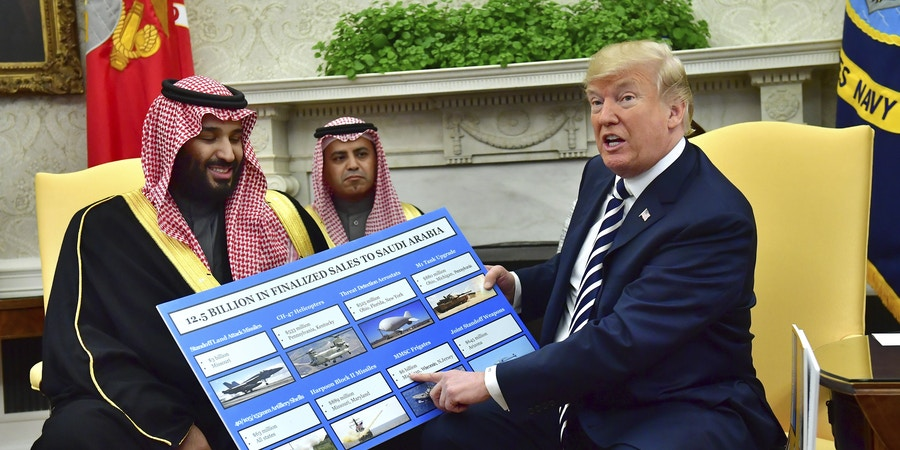 President Donald Trump (R) holds up a chart of military hardware sales as he meets with Crown Prince Mohammed bin Salman of the Kingdom of Saudi Arabia in the Oval Office at the White House on March 20, 2018 in Washington, D.C. Credit: Kevin Dietsch / Pool via CNP - NO WIRE SERVICE ' Photo by: Kevin Dietsch/picture-alliance/dpa/AP Images