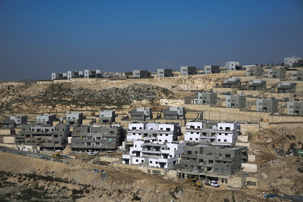 This Tuesday, Jan. 1, 2019 photo, shows a new housing project in the West Bank settlement of Naale. Data obtained by The Associated Press shows that the Israeli government -- with little resistance from a friendly White House -- has gone on a settlement push in the West Bank since President Donald Trump took office. That has laid the groundwork for what could be the largest binge in construction in years. (AP Photo/Ariel Schalit)