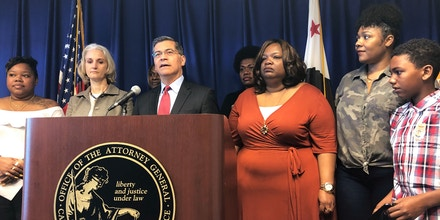 California Attorney General Xavier Becerra announces a lawsuit against the Trump Administration's new rule affecting home health care workers on Monday, May 13, 2019, in Sacramento, California. California and four other states, Connecticut, Massachusetts, Oregon and Washington want to block a new rule that bans states from using Medicaid dollars to pay third parties on behalf of employees. Becerra said the rule would not let states deduct voluntary union dues from employee paychecks, which would weaken their collective bargaining power. (AP Photo/Adam Beam)