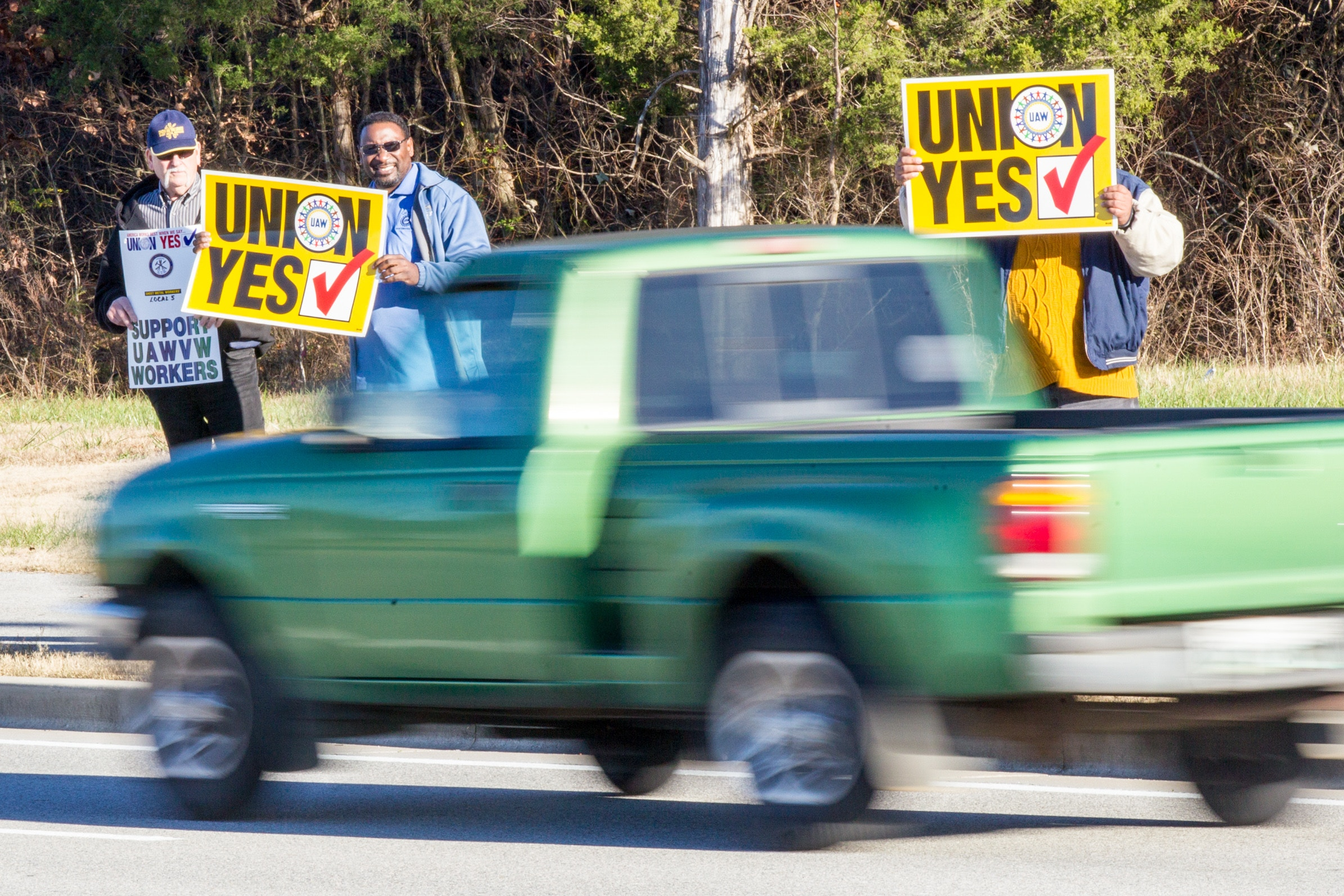 FILE - In this Dec. 4, 2015 file photo, union supporters hold up signs near the Volkswagen plant in Chattanooga, Tenn. Volkswagen announced on Monday, April 25, 2016, that it plans to appeal a National Labor Relations Board decision upholding a union vote by skilled-trades workers at the plant. (AP Photo/Erik Schelzig, file)