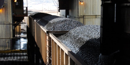 Coal is loaded onto hopper cars at Cloud  Peak Energy's Spring Creek Mine near Decker, Mont., on April 4, 2013.