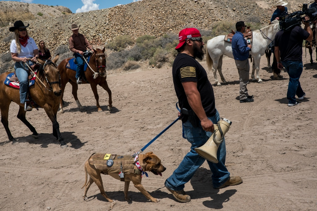 A man who said his name was Juan Zamora and his dog Spud attend a tour of the U.S.-Mexico border with Trump supporters, at Monument One on the outskirts of Sunland Park, New Mexico, Saturday, May 11, 2019. (Joel Angel Juárez for The Intercept)