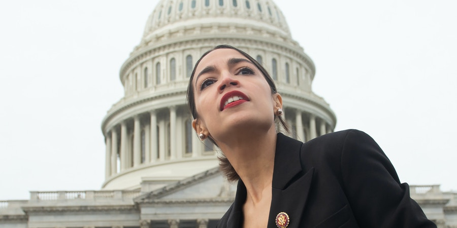 TOPSHOT - US Representative Alexandria Ocasio-Cortez, Democrat of New York, leaves a photo opportunity with the female Democratic members of the 116th US House of Representatives outside the US Capitol in Washington, DC, January 4, 2019. (Photo by SAUL LOEB / AFP)        (Photo credit should read SAUL LOEB/AFP/Getty Images)