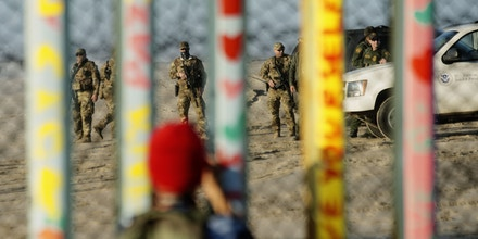 TIJUANA, MEXICO - JANUARY 06: Border Patrol agents stand on Patrol along the U.S.-Mexico border wall on January 6, 2019 in Tijuana, Mexico.  The U.S government is going into the third week of a partial shutdown with Republicans and Democrats at odds on agreeing with President Donald Trump's demands for more money to build a wall along the U.S.-Mexico border.(Photo by Sandy Huffaker/Getty Images)