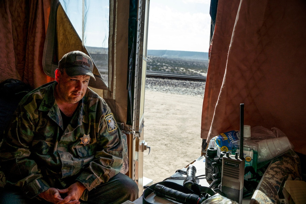 "United Constitutional Patriots New Mexico Border Ops militia team member Jim Benvie, 43, from Minnesota, sits inside the team's camper before going out on patrol along the US/ Mexico border for the night in Anapra, New Mexico on March 20, 2019. - The militia members say they will patrol the US-Mexico border near Mt. Christo Rey, ""Until the wall is built."" In recent months, thousands of Central Americans have arrived in Mexico in several caravans in the hope of finding a better life in the United States. US President Donald Trump has branded such migrants a threat to national security, demanding billions of dollars from Congress to build a wall on the southern US border. (Photo by Paul Ratje / AFP)        (Photo credit should read PAUL RATJE/AFP/Getty Images)"