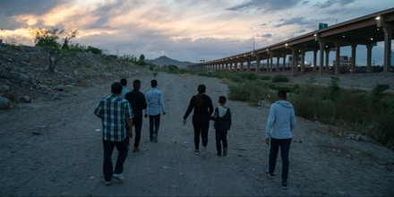 Immigrants attempt to enter the US between Ciudad Juarez, Mexico and El Paso, Texas, on April 29, 2019. - Family apprehensions in El Paso area have topped about 60,000 individuals, an increase of 1,670%, up from about 3,000 last year, according to officials. (Photo by Paul Ratje / AFP)        (Photo credit should read PAUL RATJE/AFP/Getty Images)