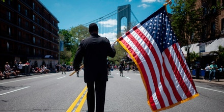 A veteran carries an American flag as he marches on the street May 27, 2019 during the 152nd Memorial Day Parade in the New York City borough of Brooklyn. - The Kings County Parade is one of the oldest Memorial Day Parades in the nation. (Photo by Johannes EISELE / AFP)        (Photo credit should read JOHANNES EISELE/AFP/Getty Images)
