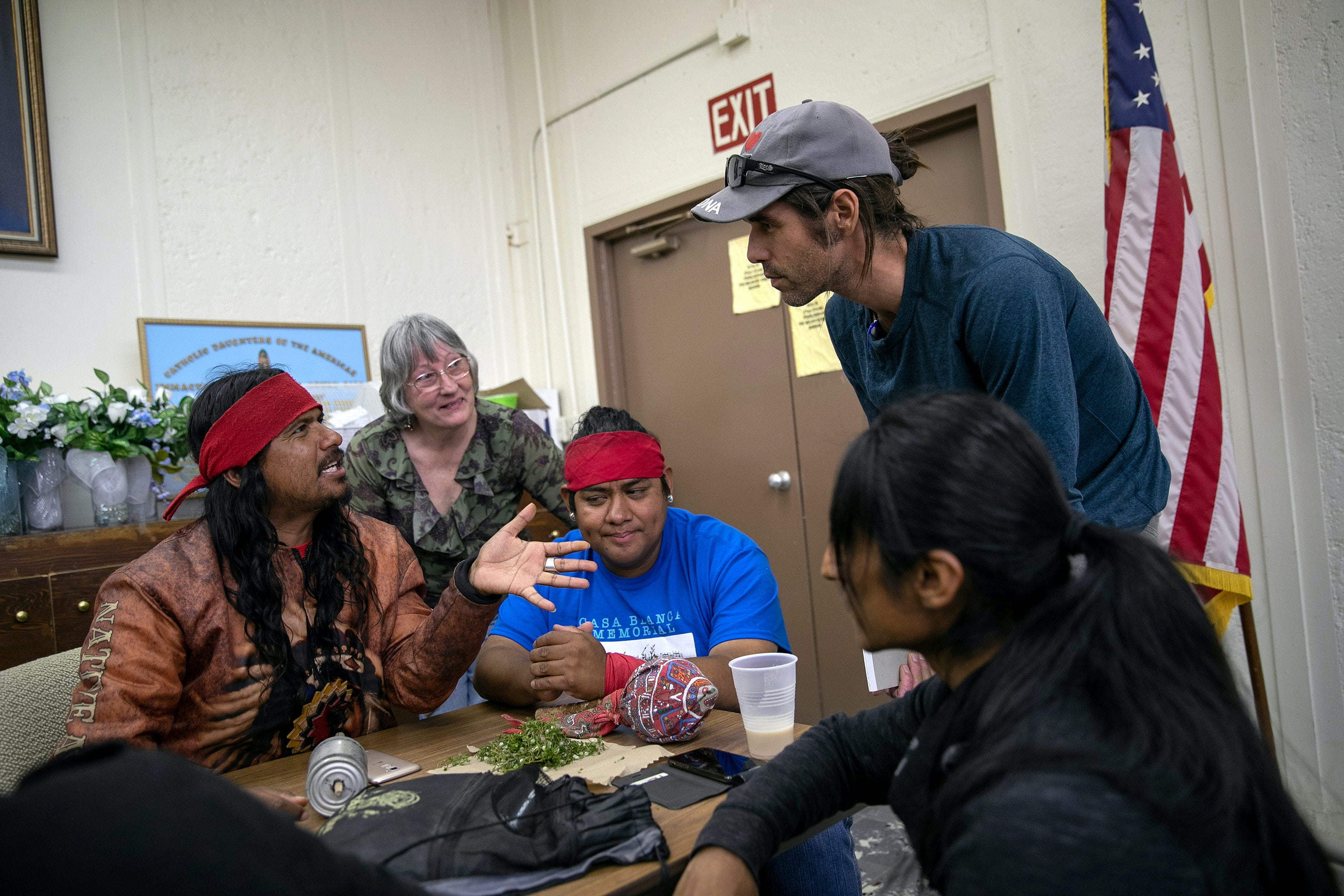 AJO, ARIZONA - MAY 10: Scott Warren, a volunteer for the humanitarian aid organization No More Deaths speaks with local residents during a community meeting to discuss federal charges against him for aiding undocumented immigrants on May 10, 2019 in Ajo, Arizona. Warren is scheduled to appear in court for felony charges on May 29 in Tucson, accused by the U.S. government on two counts of harboring and one count of conspiracy for providing food, water, and beds to two Central American immigrants in January, 2018. If found guilty Warren could face up to 20 years in prison. The trial is seen as a watershed case by the Trump Administration, as it pressures humanitarian organizations working to reduce suffering and deaths of immigrants along the border. The government says the aid encourages human smuggling. In a separate misdemeanor case, federal prosecutors have charged Warren with public littering, for distributing food and water along migrant trails. (Photo by John Moore/Getty Images)