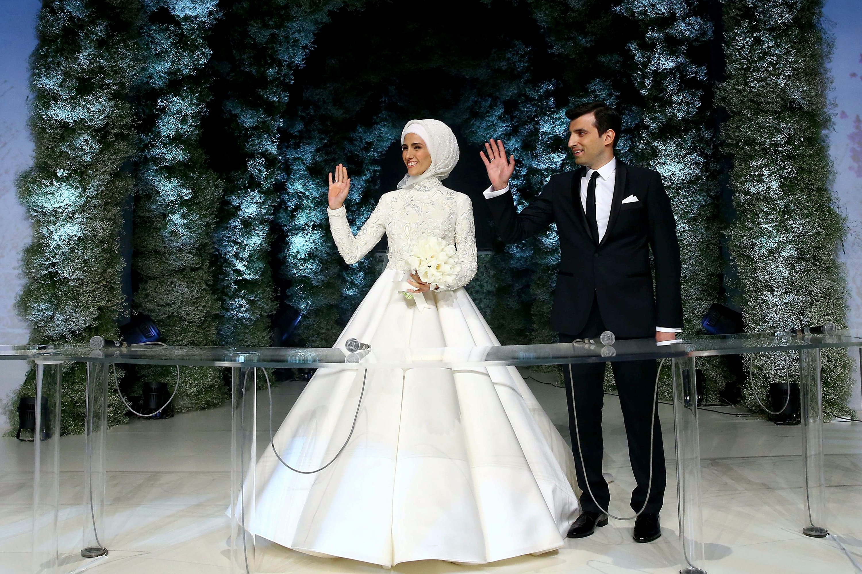 Sumeyye Erdogan, left, and Selcuk Bayraktar wave during their wedding ceremony in Istanbul on May 14, 2016.