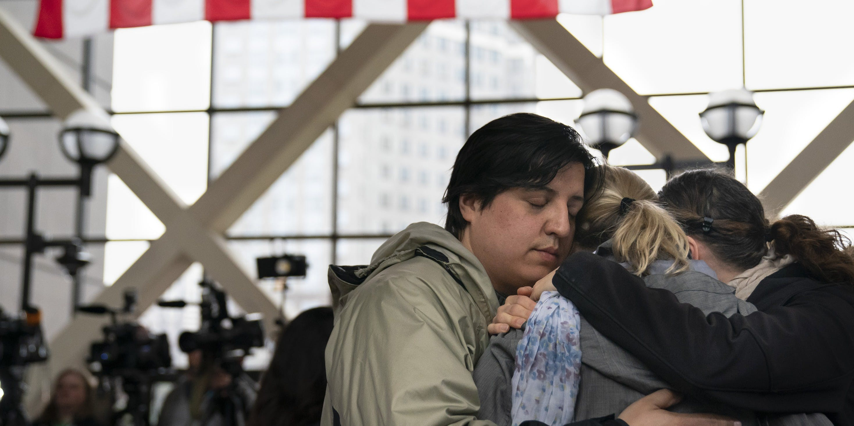 MINNEAPOLIS, MN - APRIL 30: Ryan Masterson and his wife Jenelle Masterson, right, hugged Sarah Kuhnen after former Minneapolis police officer Mohamed Noor was found guilty of third-degree murder and second-degree manslaughter in the shooting death of Justine Ruszczyk Damond in Minneapolis, Minn., on Tuesday, April 30, 2019. They are all neighbors and friends of Justine and members of Justice for Justine. (Photo by Renee Jones Schneider/Star Tribune via Getty Images)