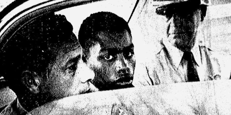 In this February 1964 file photo, Henry Montgomery, flanked by two deputies, awaits the verdict in his trial for the murder of Deputy Sheriff Charles H. Hurt in Louisiana. A three-member panel must decide whether to grant parole to Montgomery, a prisoner who's getting his first chance at freedom after nearly a half-century behind bars, Louisiana's attorney general ruled Wednesday, Feb. 7, 2018. (John Boss/The Advocate via AP, File)