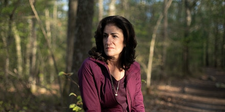 Mansfield, MA -- 05/09/2019 -- Ellen Gallagher poses for a portrait during a walk in a park near her home on May 8, 2019, in Mansfield, Massachusetts. She walked through this park almost every day over the last 4.5 years, while engaged in the process of bringing the information about immigration detainment to light. She would often sit on a rock during the walk to think, process, and sometimes pray about the issue, and the part she plays in the situation. (Kayana Szymczak for The Intercept)