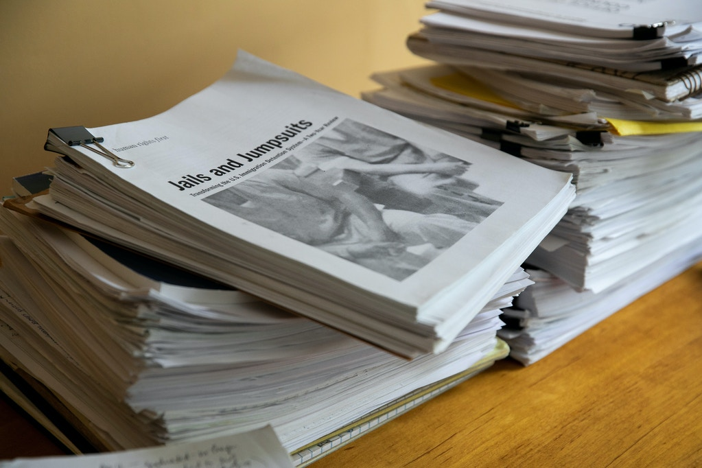 Mansfield, MA -- 05/09/2019 -- Stacks of reports, articles, and information about solitary confinement used in immigration detention is seen in the home office of Ellen Gallagher on May 9, 2019, in Mansfield, Massachusetts. This is a small part of a collection of information that she researched and used during the process of trying to understand the scope of the use of solitary confinement in immigration detention. (Kayana Szymczak for The Intercept)