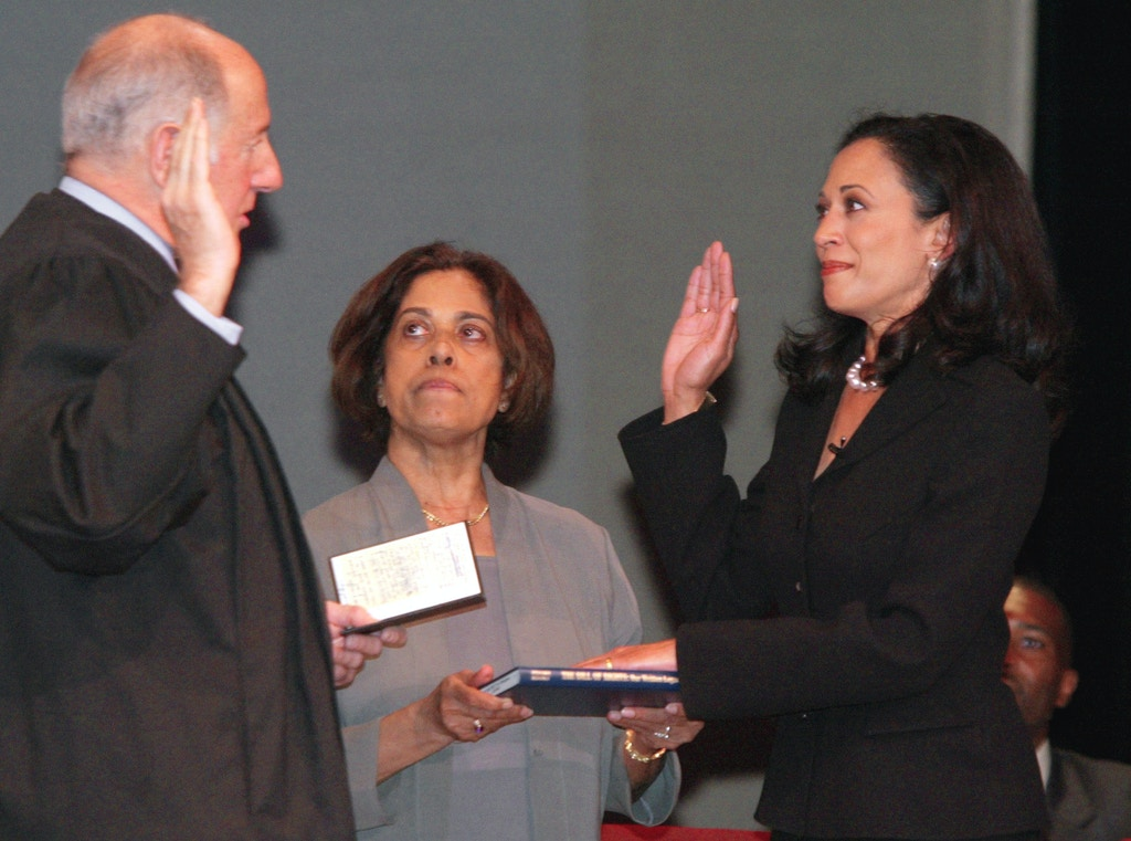 "San Francisco's new district attorney, Kamala Harris, right, receives the oath of office from California Supreme Court Chief Justice Ronald M. George, left, during inauguration ceremonies Thursday, Jan. 8, 2004, in San Francisco. In the center is Harris' mother, Dr. Shyamala Gopalan, who holds a copy of ""The Bill of Rights."" Harris, a political novice and career prosecutor, became San Francisco's chief law enforcer Thursday and California's first district attorney of Indian and black descent. (AP Photo/George Nikitin)"
