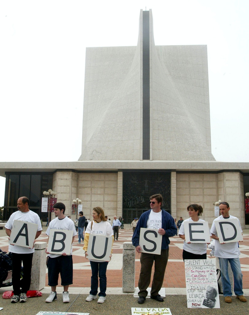 Protestors stand in front of St. Mary's Cathedral while Archbisop William Lavada of the Roman Catholic Archdiocese of San Francisco gives his final mass in San Francisco, Sunday August 7, 2005. Protesors claim that Lavata did not sufficiently pursue allegations of sexual abuse. Lavata assumes his new post as the highest appointed American official in the Vatican. Lavata is set to replace Pope Benedict XVI, to head the Vatican doctrinal office. (AP Photo/George Nikitin)