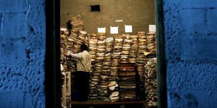 **FILE** A worker from Guatemala's Human Rights office inspects the vast quantity of police documents stored in an abandoned warehouse in Guatemala City, in this Nov 23, 2005 file photo. The newly discovered police documents confirms Guatemala's infamous National Police helped identify and kill leftists during the country's 36-year civil war. (AP Photo /Rodrigo Abd, file)
