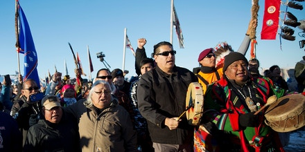 Native American tribal members and supporters march at Oceti Sakowin camp on Dec. 4, 2016, to protest the Dakota Access oil pipeline in Cannon Ball, N.D.