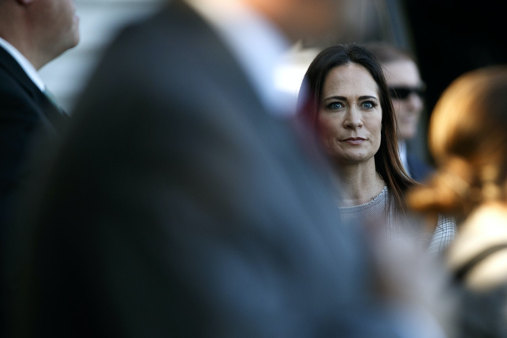 Stephanie Grisham, spokeswoman for first lady Melania Trump, watches as President Donald Trump and the first lady greet people during the annual Congressional Picnic on the South Lawn, Friday, June 21, 2019, in Washington. (AP Photo/Jacquelyn Martin)