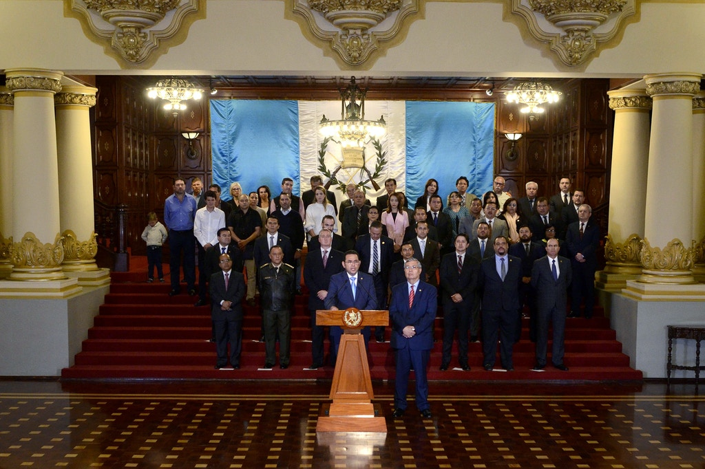 Guatemalan President Jimmy Morales (front-L), flanked by Vice-President Jafeth Cabrera (front-R) and his cabinet, gives a statement at the Culture Palace in Guatemala City on January 7, 2019. - Morales announced an immediate end to the UN-sponsored anti-corruption commission, CICIG.